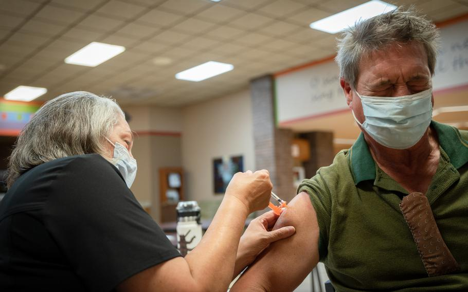 Nurse Susan Hinck gives Richard Thornton a coronavirus vaccine July 10 in Springfield, Mo., where hospital wards have filled with COVID-19 patients.
