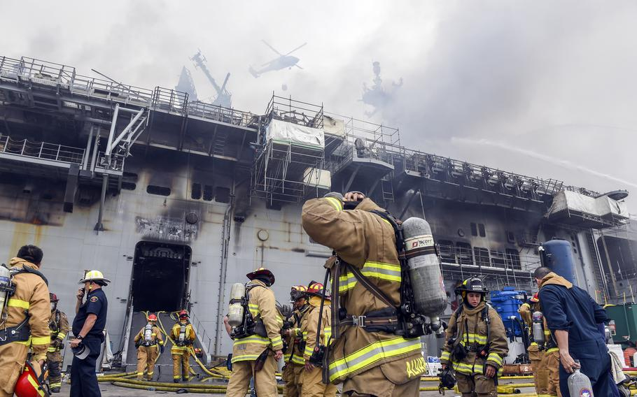 Sailors and federal firefighters respond to a blaze aboard the amphibious assault ship USS Bonhomme Richard at Naval Base San Diego, July 13, 2020.