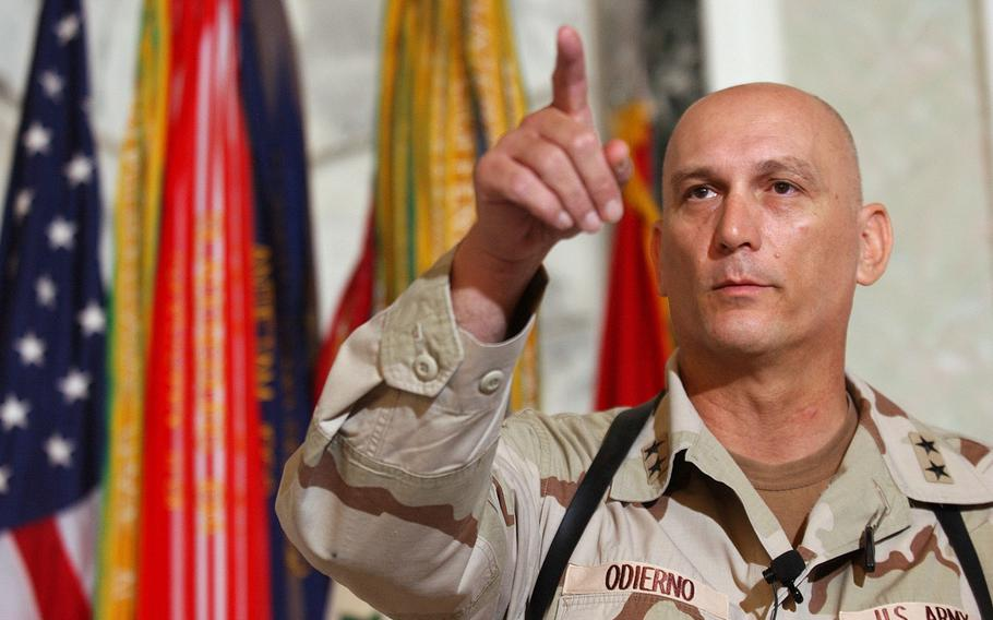 In this Aug. 7, 2003 file photo, Major Gen. Raymond Odierno, commander of the U.S. Army Fourth Infantry Division gestures during a news conference in Tikrit, about 112 miles northwest of Baghdad, Iraq.  Odierno, a retired Army general who commanded American and coalition forces in Iraq at the height of the war and capped a 39-year career by serving as the Army's chief of staff, has died, his family said Saturday, Oct. 9, 2021. He was 67.