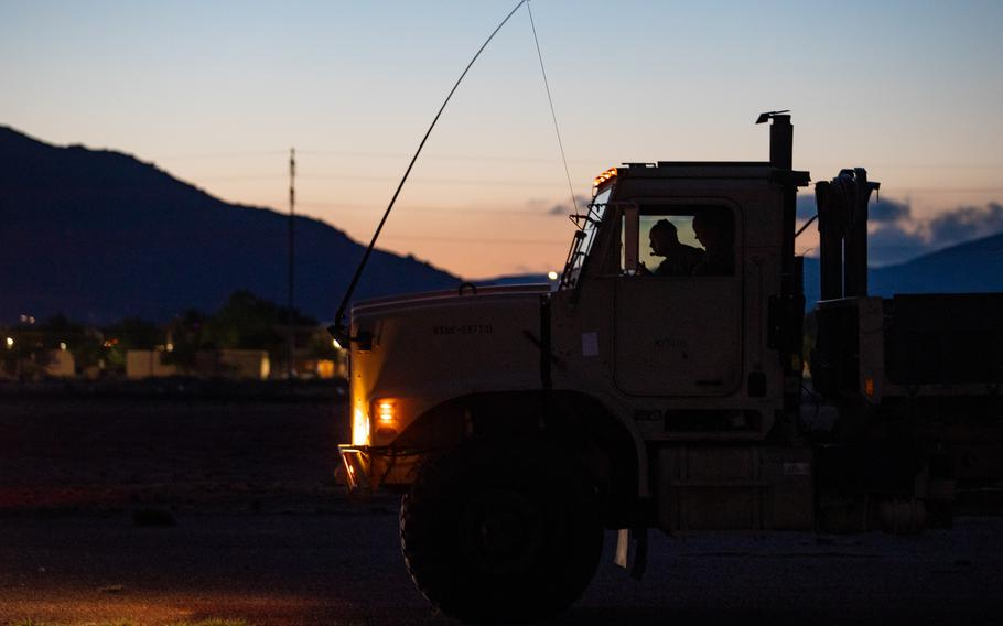 Marines prepare to depart from Kirkland Air Force Base, N. M., May 13, 2021.  Marines in tactical vehicles and trucks drove from Camp Lejeune, N.C., to Twentynine Palms, Calif., in one of the longest convoys in the service's history.