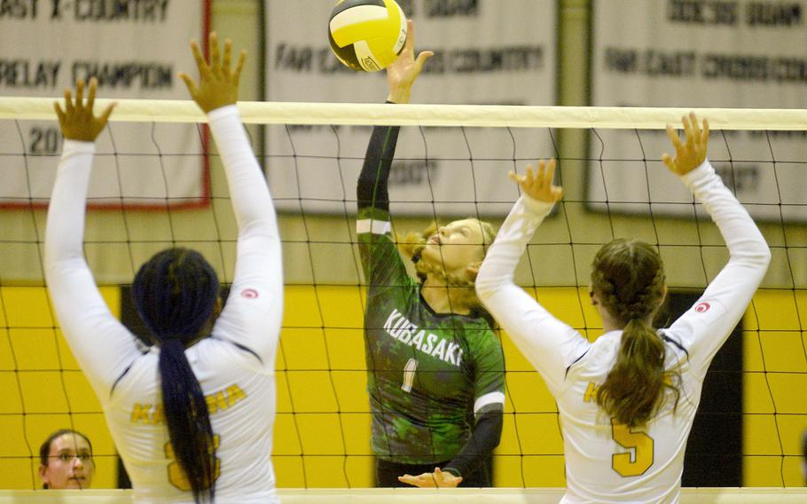 Kubasaki's Emma Leggio spikes through the double block of Kadena's Kyleigh Wright and Morgan Sayers during Tuesday's Okinawa volleyball match. The Dragons beat the Panthers in straight sets for the fifth time this season.
