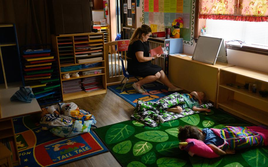 Chelsea Hallinan, 37, organizes children's take-home packets while they nap at the Begin With Us Pre-K Center in Altoona, Pa.