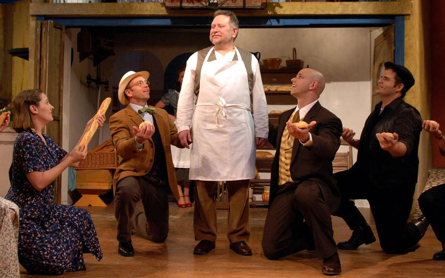 """Frank Lewandowski, center, as the baker Aimable during a dress rehearsal of  the Aviano Community Theater's """" The Bakers Wife"""" in 2008. Lewandowski, a beloved teacher at Aviano Middle High School, passed away Aug. 28, 2021, at Aviano, Italy."""