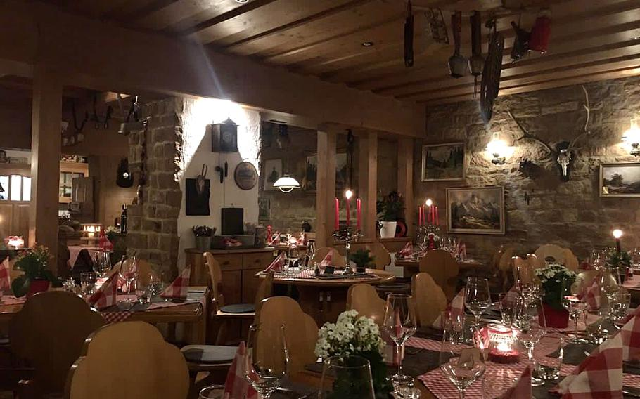 The interior of the Swiss House restaurant in Bad Duerkheim, Germany, features numerous charming Swiss mountain motifs.