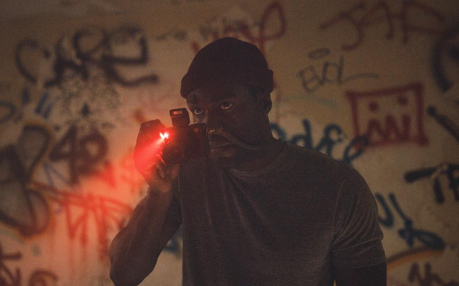 """This image released by Universal Pictures shows Yahya Abdul-Mateen II in a scene from """"Candyman,"""" directed by Nia DaCosta."""