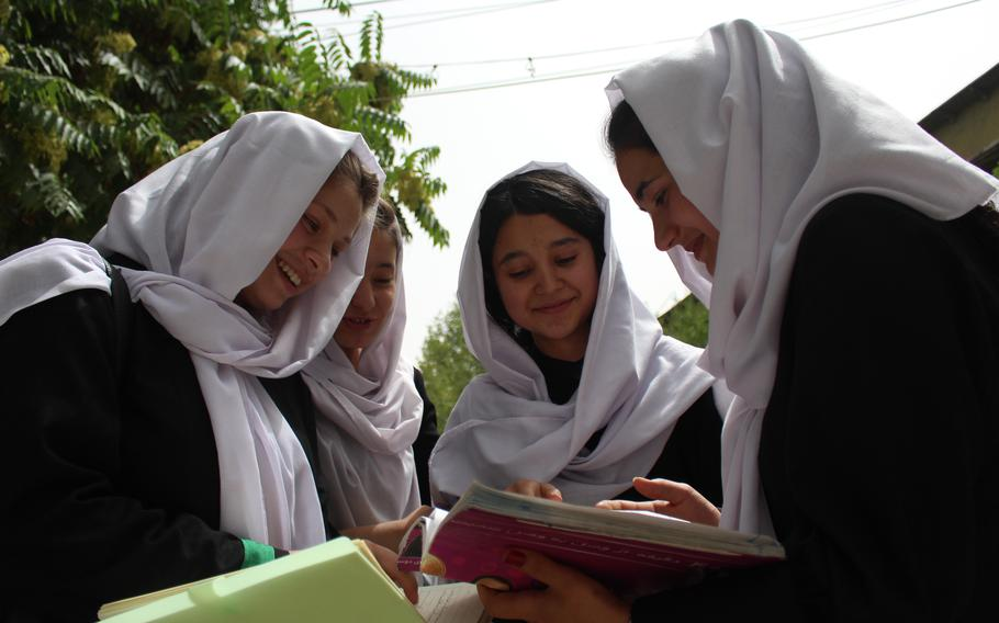 From left, the three members of the Best Friend Group at Zarghoona High School: Belqees Niazi, 17, Behishta Amini, 18, and Safia Hussain, 18, with an unidentified girl second from left.