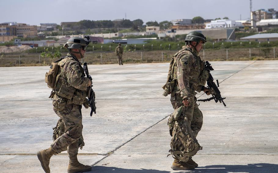 U.S. soldiers from the East African Response Force walk toward a C-130J Super Hercules Jan. 21, 2021, in Somalia. U.S. military officials are developing a proposal to send dozens of special operations troops back into Somalia, where security conditions have worsened in the months since nearly 700 troops were pulled out of the country, The New York Times reported Tuesday.