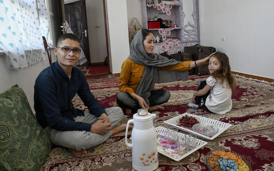 Mohammed Naiem Asadi, his wife Rahima, and their daughter Zainab, 5, share a meal in their hiding spot of six months before leaving Afghanistan for the U.S. on May 31, 2021. They received parole, a temporary status to enter the U.S. without formal admission. Other Afghans at risk due to the recent Taliban takeover of the country may also receive the status in the coming weeks, a U.S. official said.