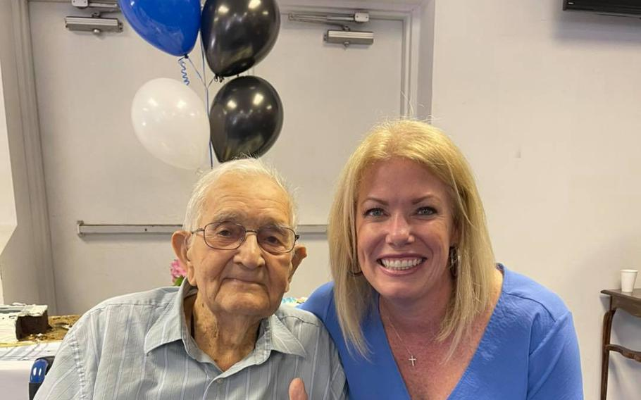 World War II veteran Edward Elrod with Delaware state Sen. Nicole Poore at his 100th birthday celebration.