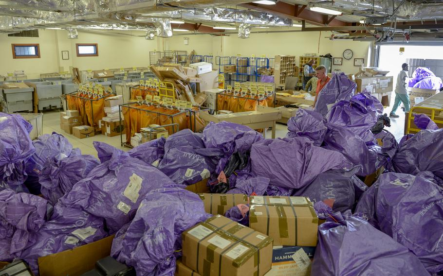 Personnel at Camp Lemonnier's post office prepare for the holiday rush of mail Dec. 12, 2019. A temporary increase to U.S. Postal Service shipping rates from Oct. 3, 2021, to Dec. 26, 2021, for the peak holiday period, will affect service members and others outside the U.S. who have military or diplomatic mailing addresses.
