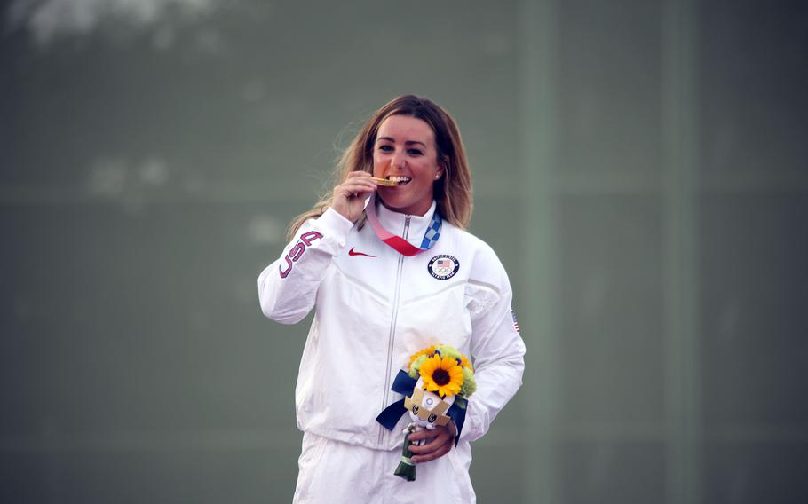 First Lt. Amber English, a logistics officer and member of the Army Marksmanship Unit, celebrates her gold-medal win in women's shotgun skeet at Camp Asaka, Japan, Monday, July 26, 2021.