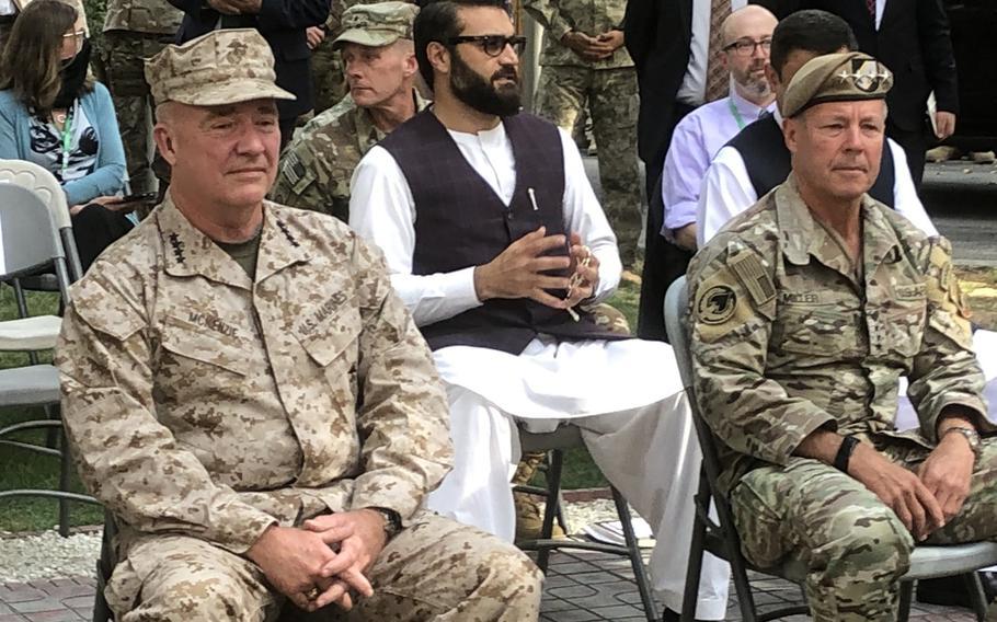 U.S. Marine Corps Gen. Frank McKenzie, left, sits near Gen. Scott Miller in Afghanistan on Monday, July 12, 2021.