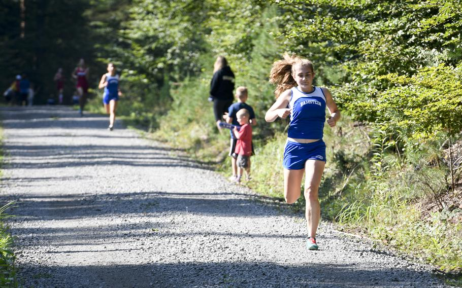 Brenna Mack, 16, a junior at Ramstein, finishes as the winner of the high school girls' varsity cross country race Saturday, Sept. 18, 2021, in Kaiserslautern, Germany.