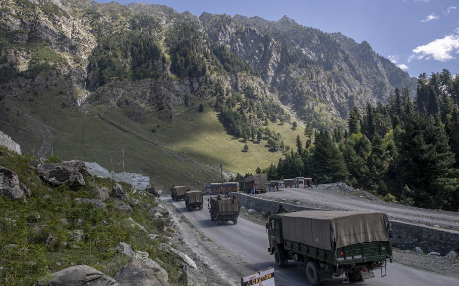An Indian army convoy moves on the Srinagar- Ladakh highway at Gagangeer, northeast of Srinagar, Indian-controlled Kashmir on Sept. 9, 2020. Indian and Chinese army commanders met Sunday, Oct. 10, 2021, and discussed steps to disengage troops from key friction areas along their disputed border to ease a 17-month standoff that has sometimes led to deadly clashes, an Indian army spokesman said.