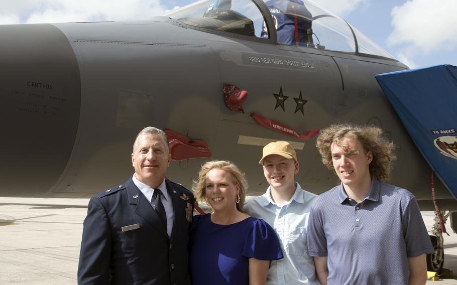 Brig. Gen. David Eaglin, the newly minted 18th Wing commander, poses with his family near an F-15C Eagle bearing his name at Kadena Air Base, Okinawa, Friday, July 16, 2021.