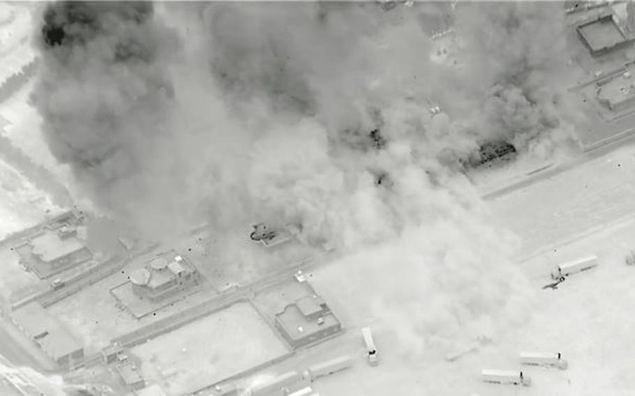 This screenshot from a U.S. military video shows airstrikes conducted Sunday, June 27, 2021, near the border between Iraq and Syria.