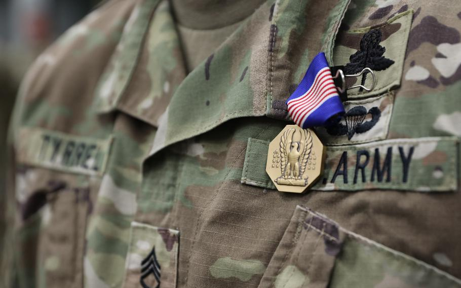 Sgt. Ian Tyrrel receives the Soldier's Medal for heroism on July 14, 2021, at Fort Campbell, Ky. Tyrrel was awarded the medal for saving an injured woman's life on what was supposed to be a relaxing kayak trip on Tennessee's Red River.