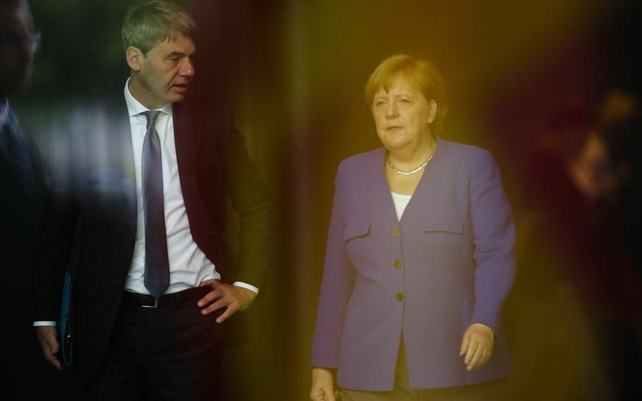 German Chancellor Angela Merkel, right, talks to then foreign policy advisor Jan Hecker, left, as she arrives to welcome the Prime Minister of North Macedonia Zoran Zaev for a meeting at the chancellery in Berlin, Germany, June 13, 2019. Hecker, Germany's new ambassador to China, a former adviser to Merkel, has died, the German Foreign Ministry said Monday, Sept, 6, 2021.