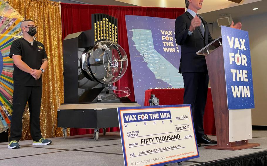 California Gov. Gavin Newsom draws first the 15 winners in the state's Vax for the Win program.