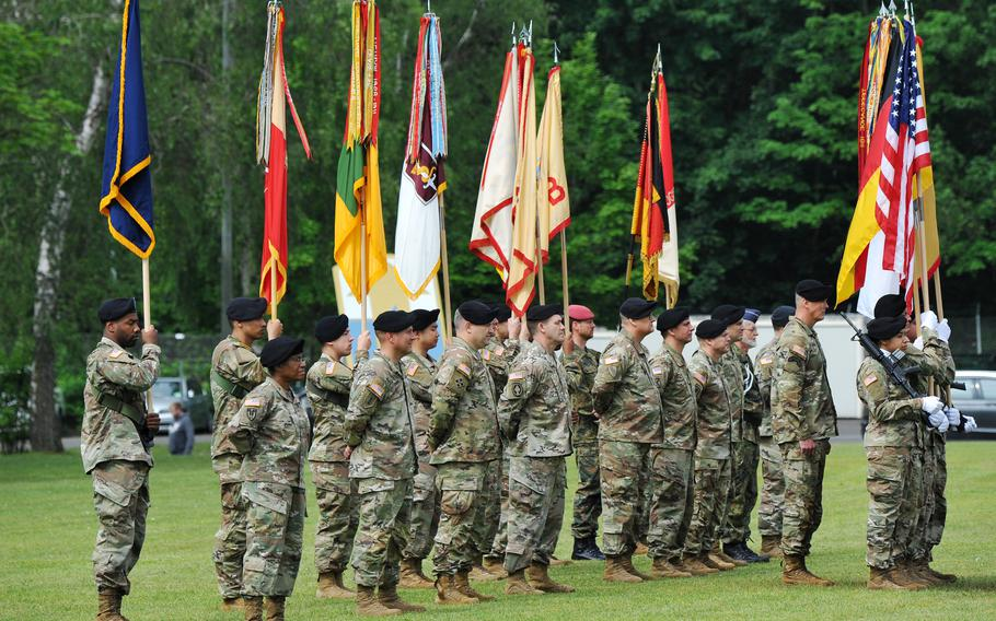 The color guard and soldiers of the 21st Theater Sustainment command stand on the Daener Kaserne parade ground during the unit's change of command ceremony at Daenner Kaserne, Kaiserslautern, Germany, June 8, 2021.