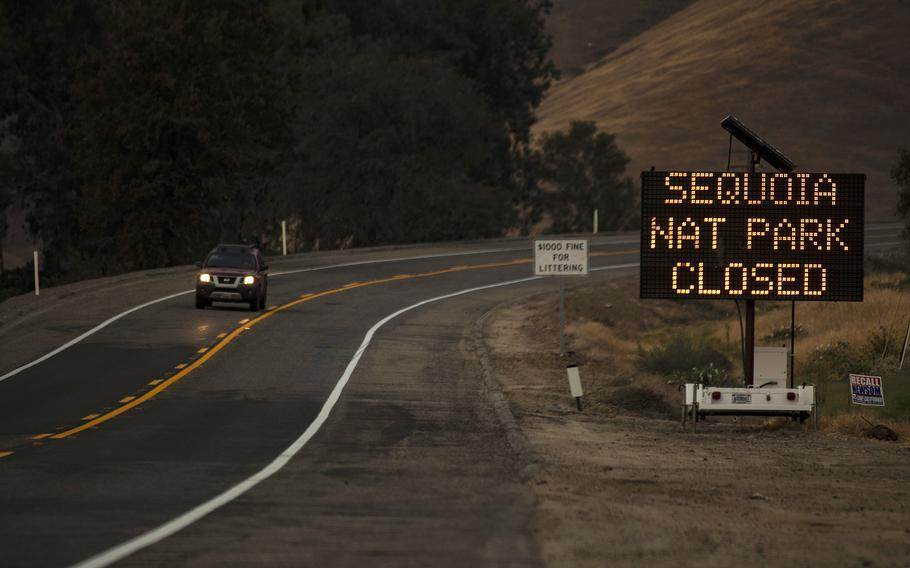 A sign warns motorists of the closure of Sequoia National Park as the KNP Complex fire threatens the area on Sept. 15, 2021 in Three Rivers, Calif.