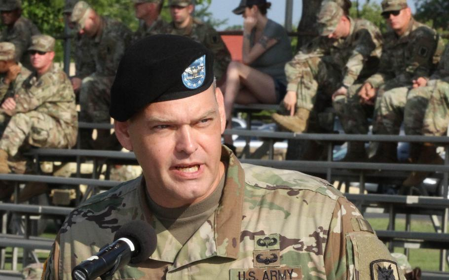 """Col. Matthew Foulk, 35th Theater Tactical Signal Brigade Commander, gives his entrance speech during a change of command ceremony on July 19, 2019.  Foulk was removed from command Monday """"due to a loss of confidence"""" in his ability to command after a misconduct probe was conducted, according to an Army statement. (U.S. Army)"""