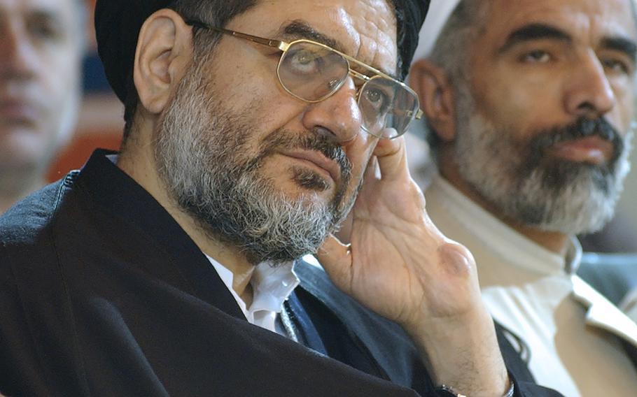 Ali Akbar Mohtashamipour attends a meeting in Tehran, Iran, on Dec. 4, 2003. Mohtashamipour, a Shiite cleric who as Iran's ambassador to Syria helped found the Lebanese militant group Hezbollah and lost his right hand to a book bombing reportedly carried out by Israel, died Monday, June 7, 2021, of the coronavirus.
