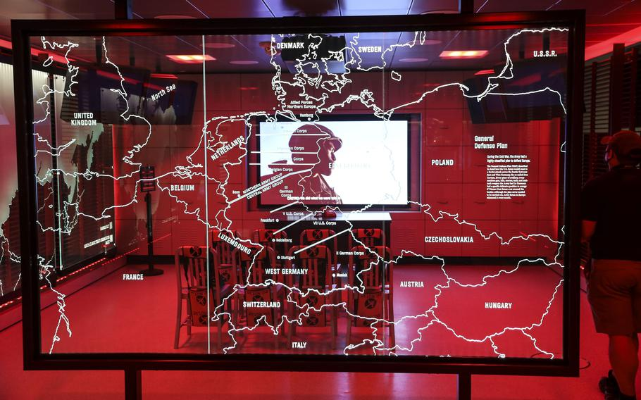 A video plays behind a map of Europe in the Cold War exhibit at the National Museum of the United States Army on its reopening day, June 14, 2021.