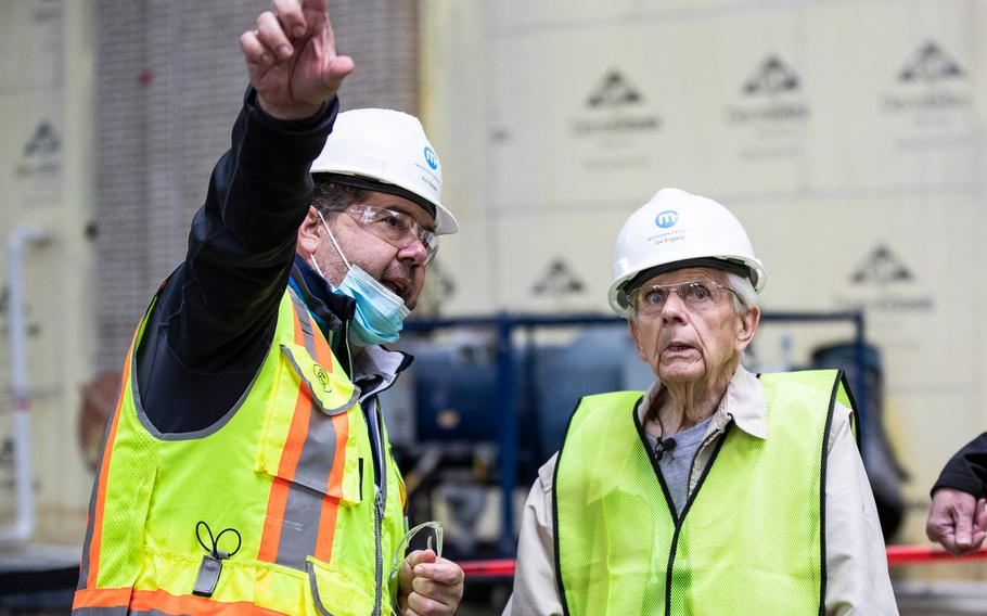 Michigan Central construction manager Richard Bardelli, left, guides George England for a tour inside Michigan Central Station in Detroit on Sept. 25, 2021.
