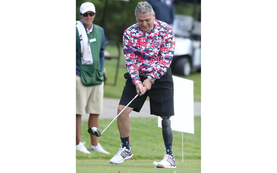 Major Ed Pulido, the founder and CEO of the John Daly-Major Ed Heart of a Lion Foundation, tees off on 17 on the North Course at Firestone Country Club on Tuesday, June 22, 2021, in Akron, Ohio.
