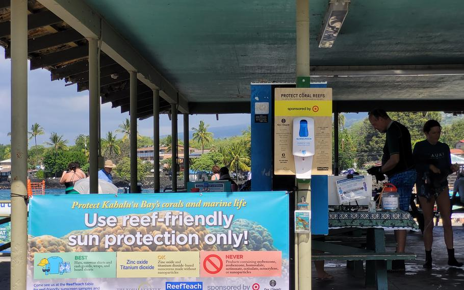 One way to help protect coral reefs is to choose sunscreen products without oxybenzone, such as Raw Elements, which is available in dispensers at Kahaluu Beach Park in Hawaii.