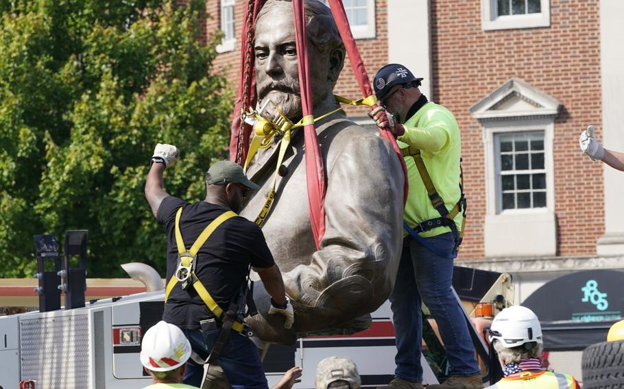 Crews remove the torso of Confederate General Robert E. Lee,  one of the country's largest remaining monuments to the Confederacy, on Monument Avenue in Richmond, Va., Wednesday, Sept. 8, 2021.