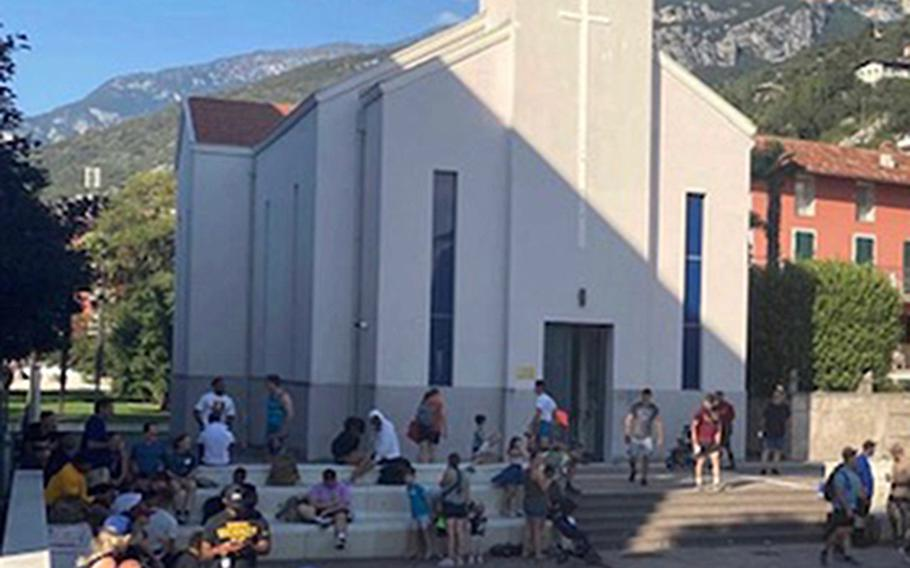 Paratroopers from the 173rd Airborne Brigade take a load off in the town square of Torbole, Italy, on Sept. 2, 2021, at the end of a 40-mile hike along Lake Garda. The annual hike commemorates then-Col. William Darby, the founder of the U.S. Army Rangers, and 25 infantry troops killed there in April 1945.