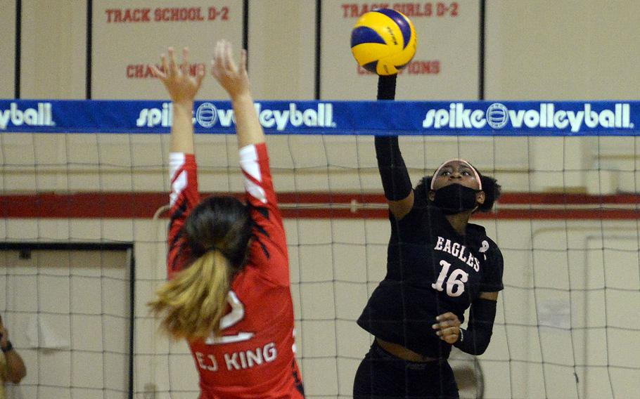 Robert D. Edgren's Jaylie Johnson rifles a spike past E.J. King's Kathryn Kindt during Friday's DODEA-Japan volleyball match. The Eagles won in straight sets in a battle of teams that entered the weekend unbeaten without dropping a set.