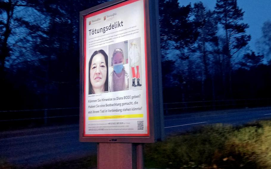 A poster on Merkurstrasse in Kaiserslautern carries photos and information about Diana Bodi, who was found dead in Kaiserslautern on Dec. 14, 2020. Kaiserslautern police on July 22, 2021, released security camera footage showing a man pulling a shopping cart with a large object wrapped in white, past a downtown Kaiserslautern parking garage near the alley where Bodi was found.