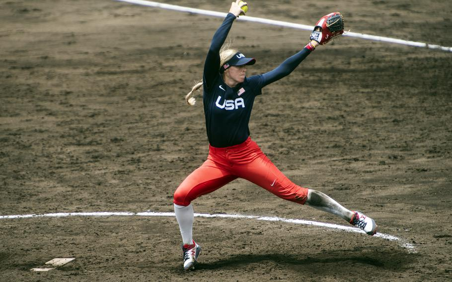 Ally Carda of the U.S. Women's Olympic softball team, winds up during an exhibition game against the Toyota Red Terriers in Iwakuni, Japan, Monday, July 12, 2021.
