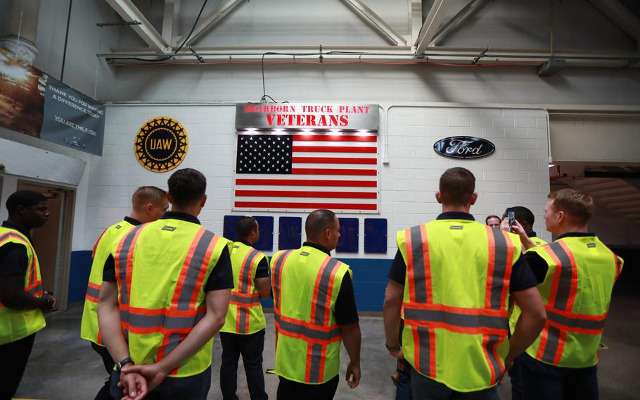 Blue Angels pilots observe the Veterans wall while touring the Dearborn Truck plant assembly line on Aug. 3, 2021.