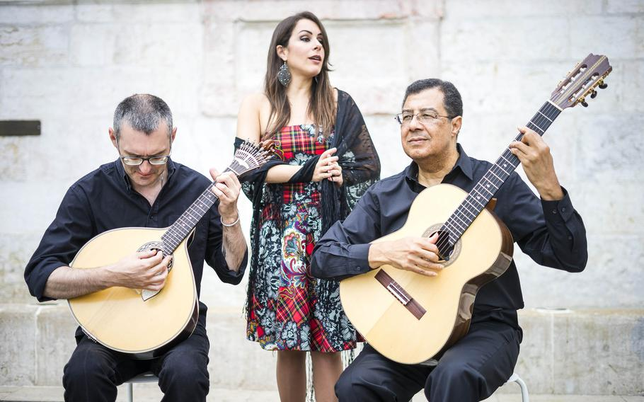 A fado band performs the traditional sounds of the melancholy style  on the square of the Alfama neighborhood in Lisbon, Portugal.