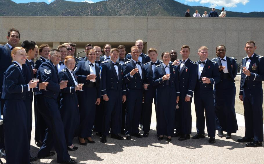 Newly commissioned second lieutenants from Cadet Squadron 14 at the U.S. Air Force Academy in Colorado Springs, Colo., drink a toast with leadership at their commissioning ceremony on May 25, 2021. Tanner Johnson, third from right, is the first person diagnosed with Type 1 diabetes to commission into the U.S. military.