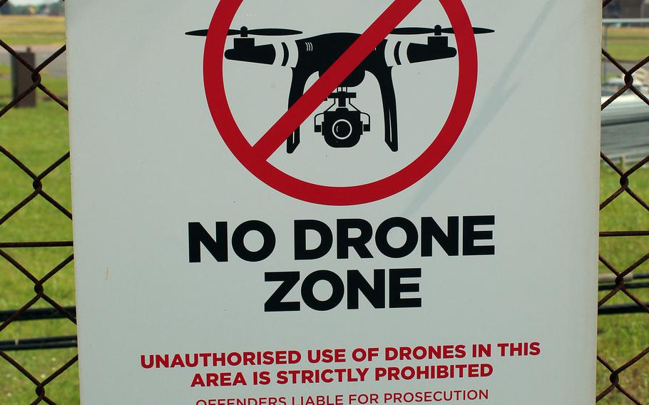 A sign posted on a perimeter fence at RAF Mildenhall in England bars the flying of drones over the base, which is home to the U.S. Air Force's 100th Air Refueling Wing.