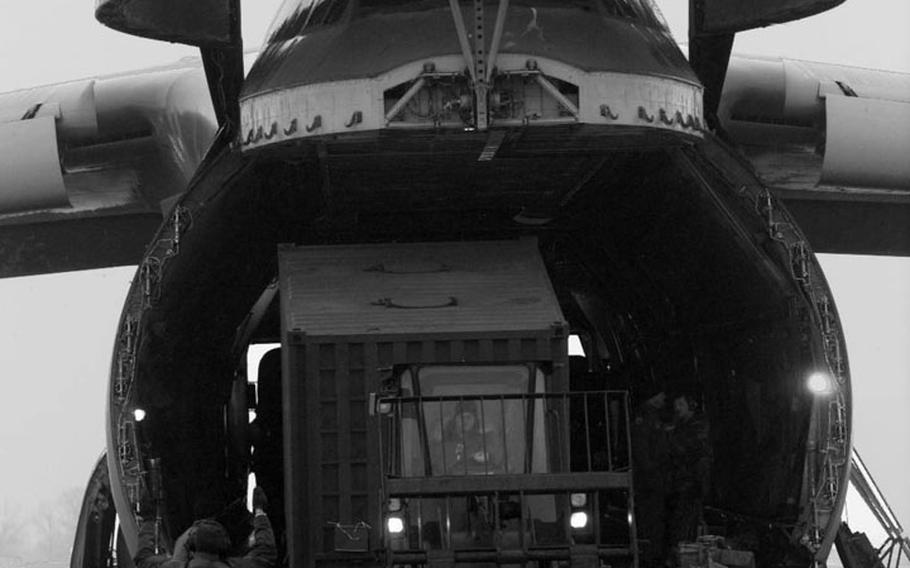 Taszar AB, Hungary, January, 1996: Air Force personnel at Taszar AB offload another cargo plane during the massive airlift that occured at the beginning of Operation Joint Endeavor.