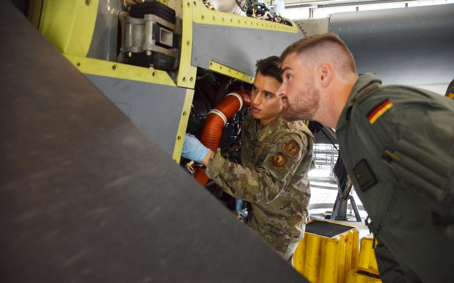 Airman 1st Class Samuel Alcala Perez, left, explains some of the workings of the C-130J to German military academy cadet Nicolas Polster on July 15, 2021, at Ramstein Air Base. Polster and six other future Luftwaffe pilots spent two weeks at Ramstein Air Base working alongside maintainers to learn what it takes to prepare aircraft for flight.