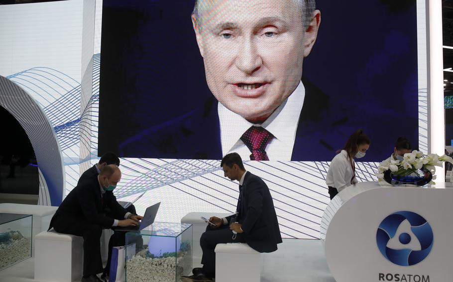 People work in the press center as they listen to Russian President Vladimir Putin speak at the St. Petersburg International Economic Forum in St. Petersburg, Russia, on Friday, June 4, 2021.