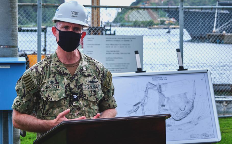 Navy Capt. Rich Jarrett, commander of Yokosuka Naval Base, speaks during a groundbreaking ceremony for a new combat loading wharf in Yokosuka, Japan, on Aug. 18, 2021.