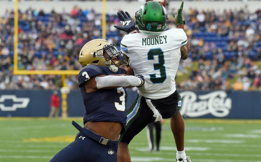 Navy defensive back Cameron Kinley, left, cannot prevent a 22-yard touchdown pass to Tulane wide receiver Darnell Mooney in the second quarter at Navy-Marine Corps Memorial Stadium in Annapolis, Md. The host Midshipmen won, 41-38.