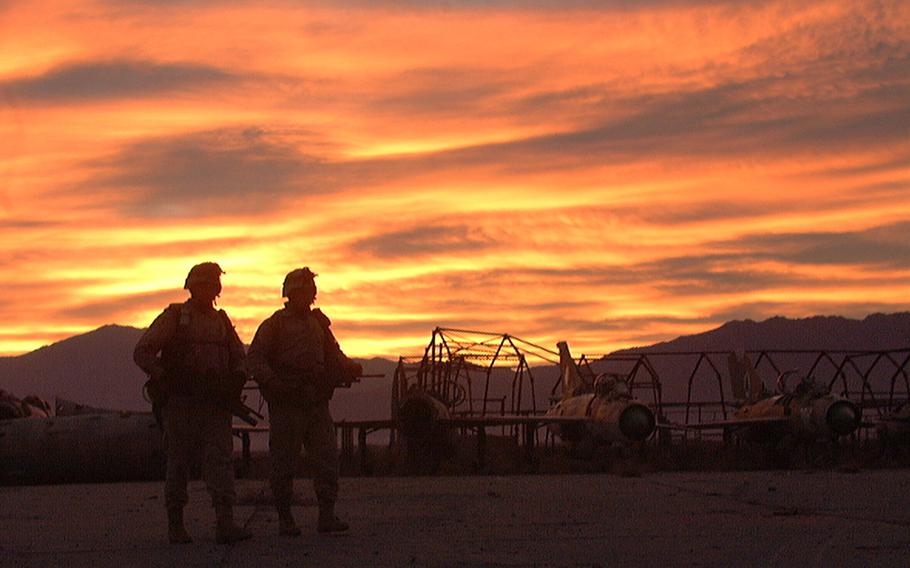 Two 10th Mountain Division soldiers head out for an early morning patrol at Bagram Airfield, Afghanistan, in December 2001. It was announced July 2, 2021, that the last U.S. troops had left Bagram, nearly 20 years after they first arrived.