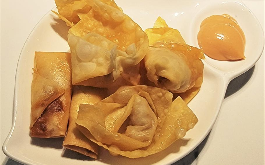 Fried spring rolls and minced meat wantons, from Kashima Sushi in Sacile, Italy. The restaurant offers an all-you-can-eat format for dine-in patrons.