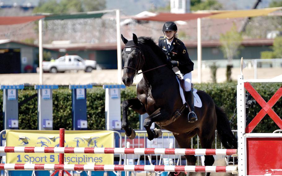 Sgt. Samantha Schultz begins the equestrian course on a randomly drawn horse during the 2018 Modern Pentathlon World Cup in Los Angeles.