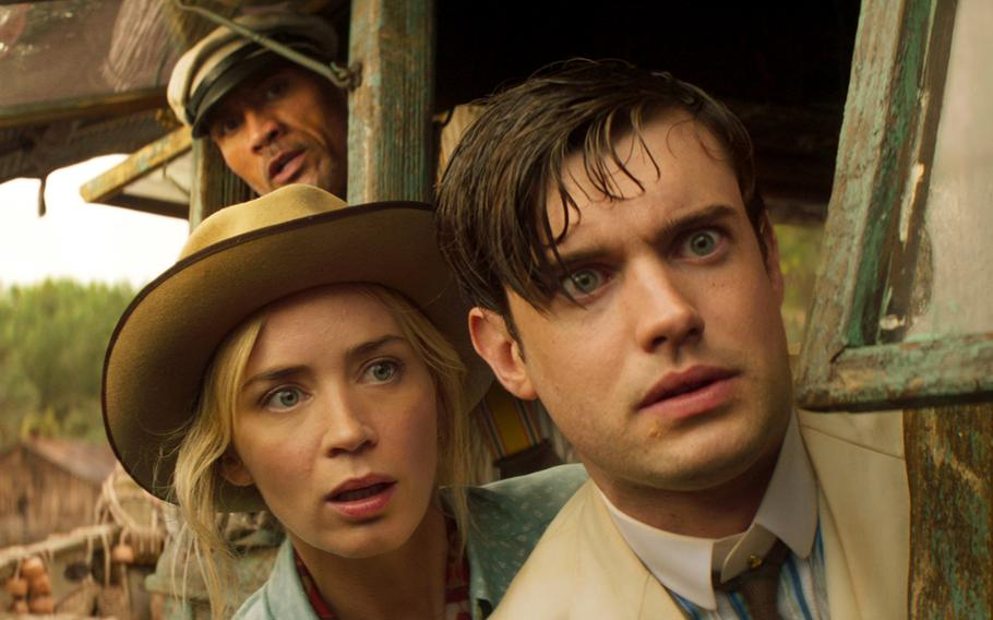 """Foreground, from left: Emily Blunt and Jack Whitehall; background: Dwayne Johnson, in """"Jungle Cruise."""""""