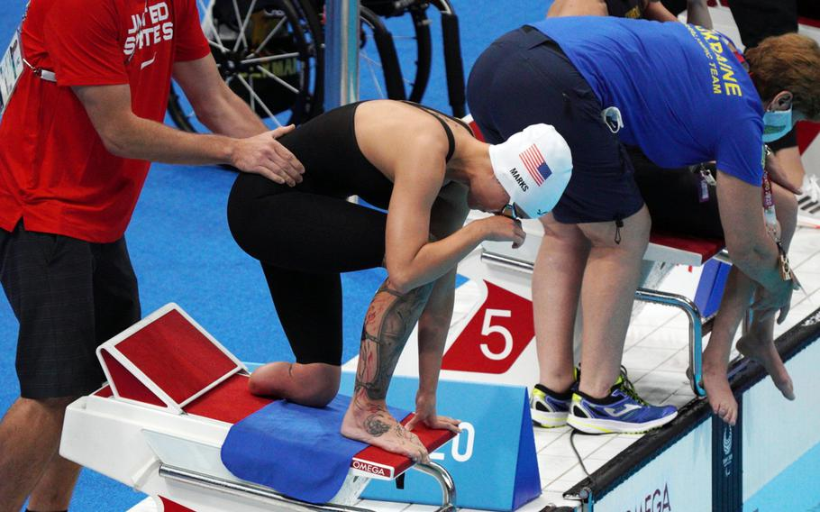 Army Sgt. 1st Class Elizabeth Marks prepares to compete in the 200-meter individual medley during the Paralympics at Tokyo Aquatics Centre, Thursday, Aug. 26, 2021.